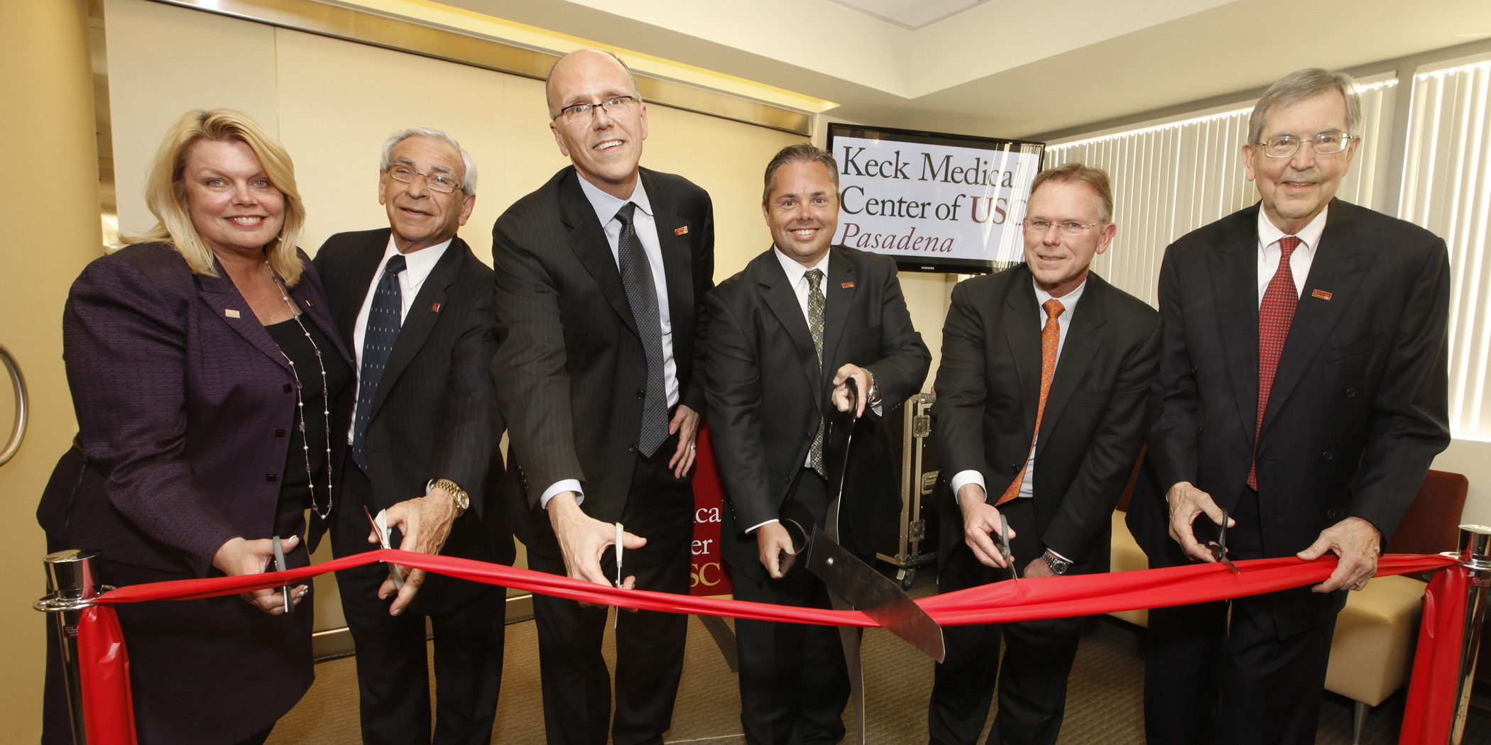 The administrators attend a ribbon-cutting ceremony in Pasadena.