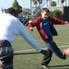 USC football player Peter Yobo plays with a child at World Health Day L.A.