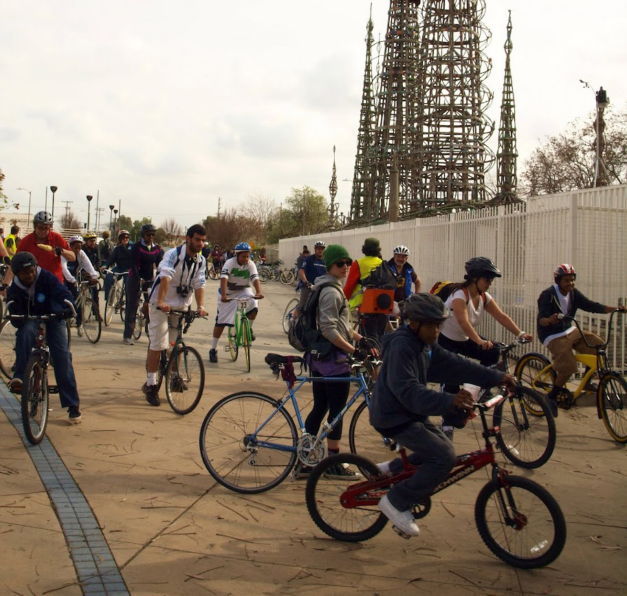 Bicyclists travel to South Los Angeles.