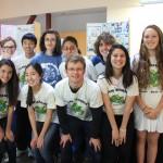 Santa Monica High School students and teacher Benjamin Kay, center