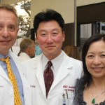 Keck School of Medicine of USC Dean Carmen A. Puliafito, left, with Felix and Mildred Yip (Photo/Brook Photography)