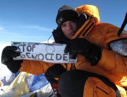 At the top of Mount Everest, Johnny Strange takes a moment to communicate a message for a cause close to his heart. (Photo/Courtesy of Johnny Strange)