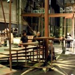 Designed by Alan Muraoka, the set for The Tempest  features two rolling staircases around a center pivot.