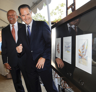 Dean Ernest J. Wilson III, left, and Annenberg Foundation Executive Director Leonard Aube view the architectural sketches for Wallis Annenberg Hall. (Photo/Gus Ruelas)
