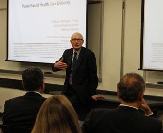 Michael Porter of the Harvard Business School visits with Keck School of Medicine of USC faculty to discuss the development of a business of medicine curricula. (Photo/Amy Hamaker)