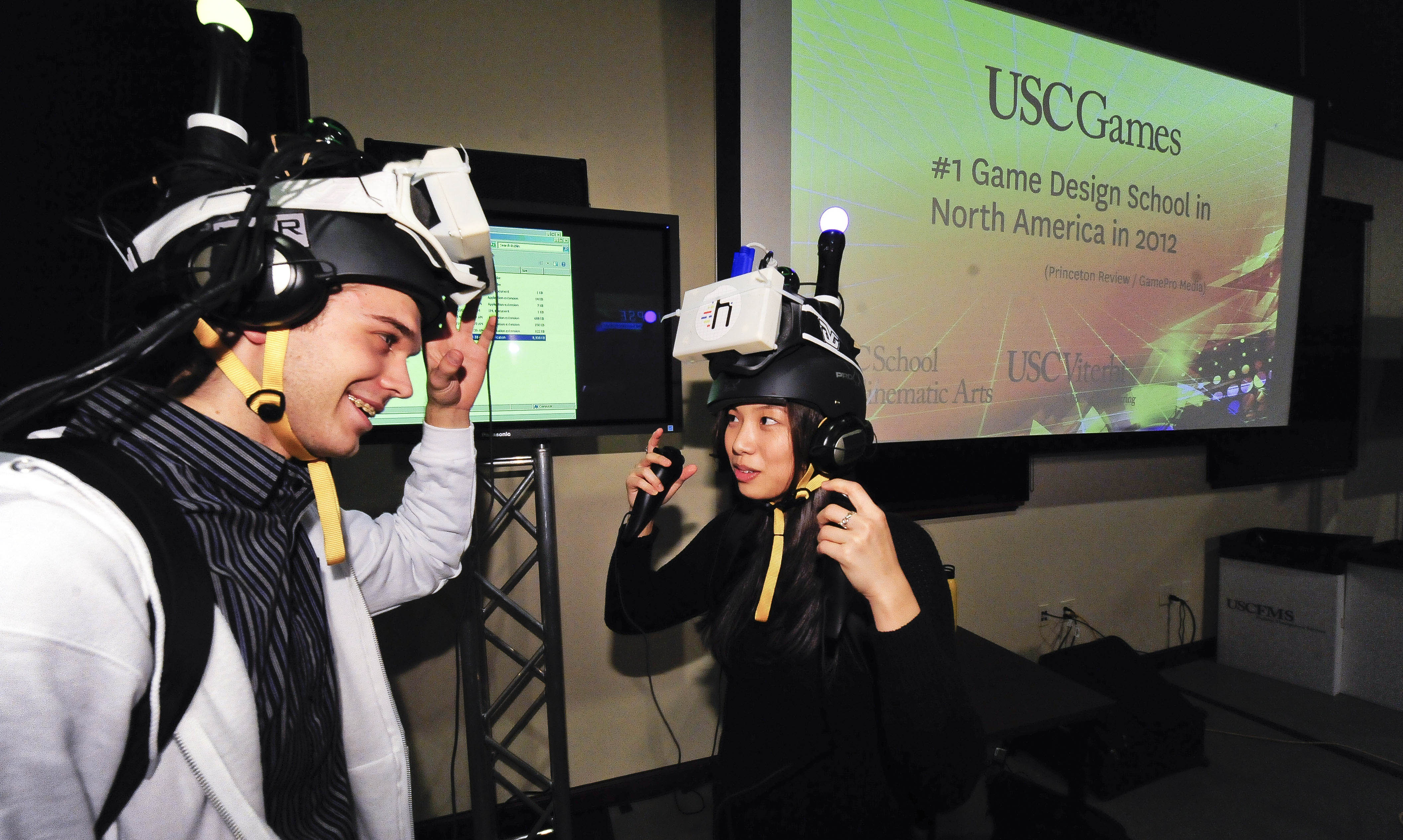 Project Holodeck's lead developer Alexander Silkin, left, and Janice Chang try out Wild Skies, an immersive 360 degree virtual reality program. (Photo/Gus Ruelas)
