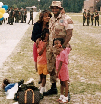MSW student Kelly Felton and her daughters welcome home Master Gunnery Sgt. Richard Felton (Ret.) following an Operation Desert Shield and Desert Storm deployment in 1991.