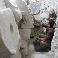Thomas Garrison cleans a recently uncovered Maya architectural mask at El Zotz, Guatemala. (Photo/Sarah Newman, reproduced courtesy of Proyecto Arqueologico El Zotz)