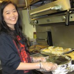 USC student Janet Lee cooks dinner for the homeless. (Photo/Lily Chowana-Bandhu)