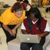 Alejandra Mendoza helps a student at USC Hybrid High. (Photo/Kathy Hernandez)