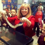 Janet Williams handles a python in her science class.
