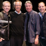 The Croods directors Chris Sanders, left, and Kirk De Micco, right, flank USC Trojan Marching Band leader Arthur Bartner and composer Alan Silvestri. (Photo/Brett Padelford)