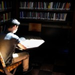 A student reads in USC's Hoose Library of Philosophy. (USC Photo/Dietmar Quistorf)
