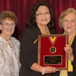 Esther Gillies, president of the California Social Welfare Archives, with Marleen Wong, winner of the George D. Nickel Award for Outstanding Service, and Dean Marilyn L. Flynn (Photo/Andrew Taylor)