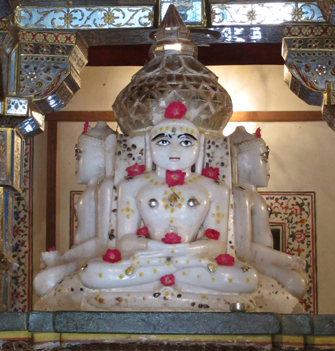 Adorned with sandalwood paste and roses, this white marble statue of a Jain Tirthankara, or Jina, an enlightened being who teaches Jainism, is from a temple in Northwest India.
