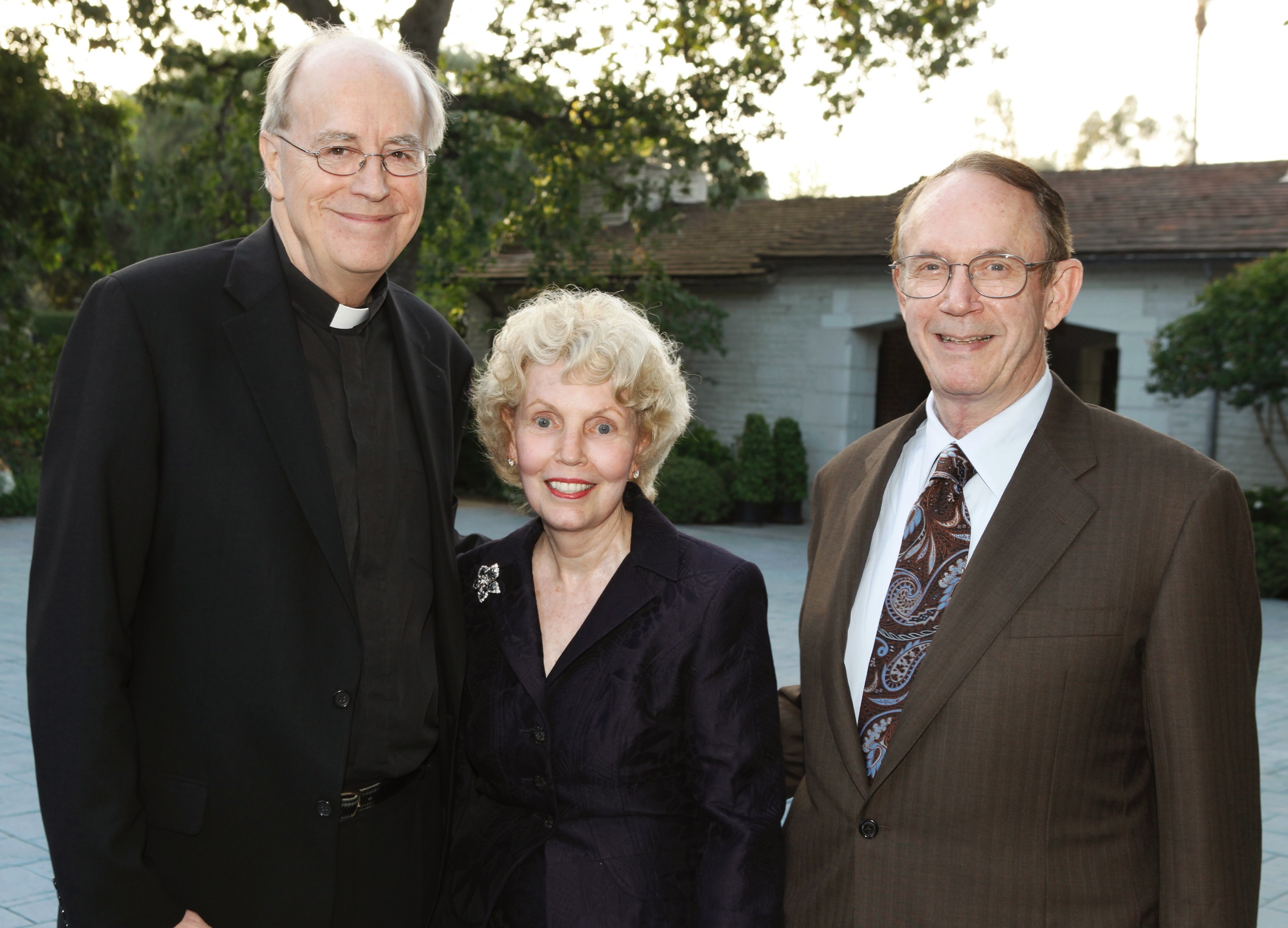 The gift creates the Steven and Kathryn Sample Endowment for Ecumenism. The Samples are pictured here with Father James Heft. (USC Photo/Steve Cohn)