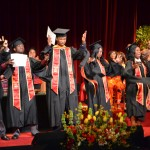 Graduates jump for joy at the 2012 African-American Cultural Celebration. (USC Photo/Lillian Insalata)
