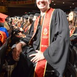 Michael Fritschner, who is paralyzed from the knees down, at commencement (Photo/Erica Christianson)