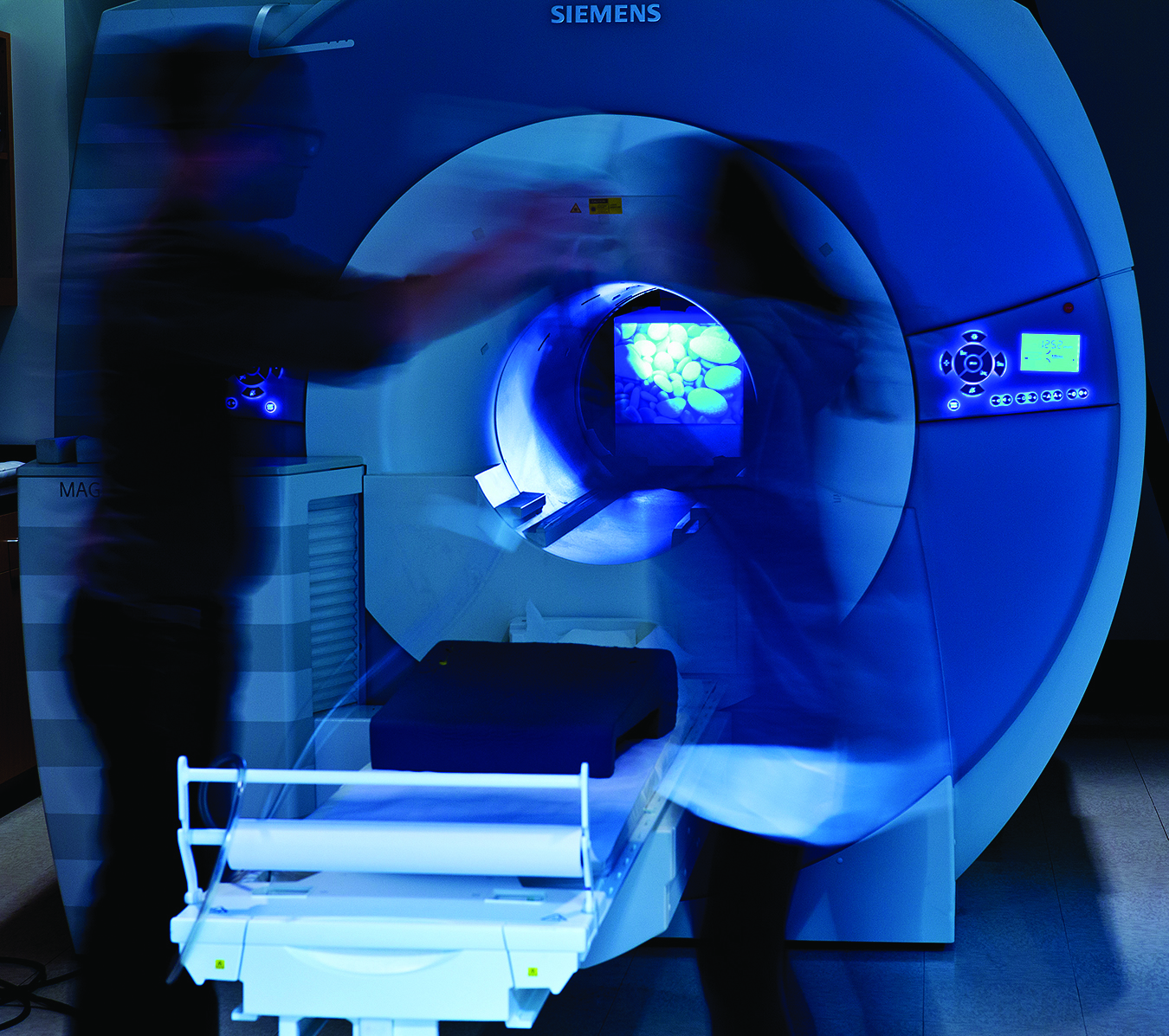 BCI researchers use the functional magnetic resonance imaging scanner to study the human mind. (Photo/John Livzey)