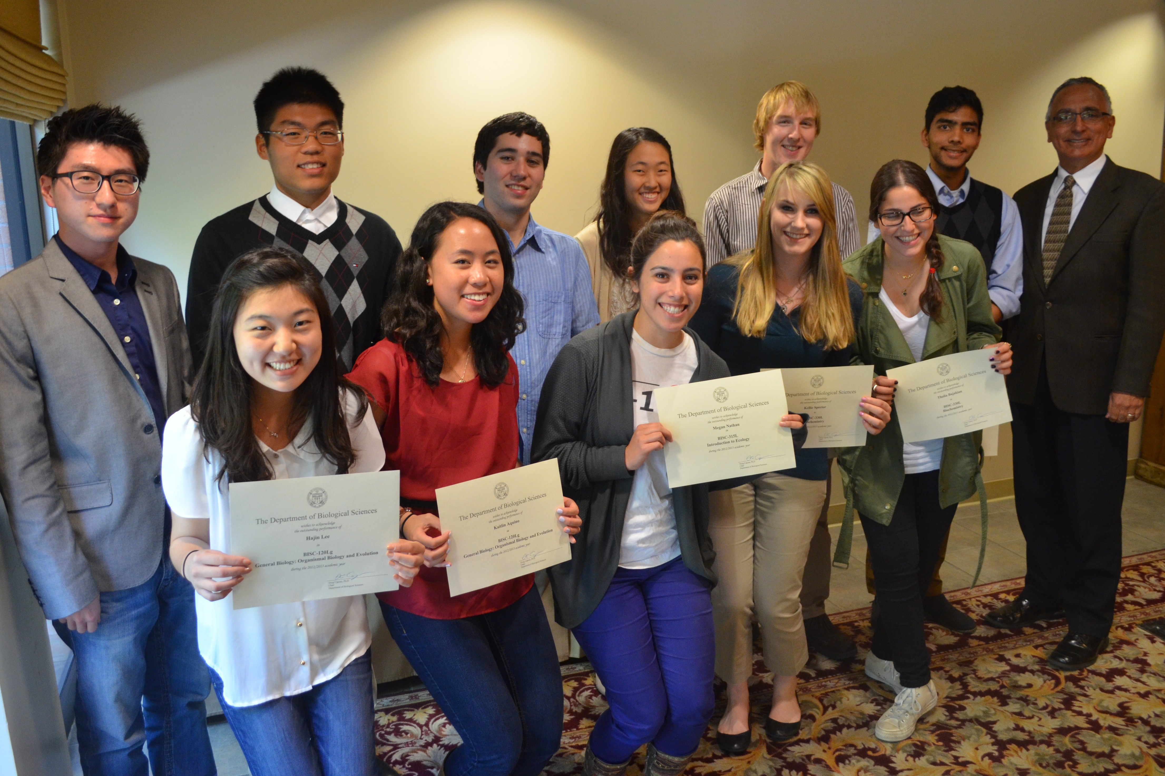 Students recognized as outstanding undergraduates in biological sciences honors core courses display their awards with Professor Albert Herrera of USC Dornsife. (Photo/Erica Christianson)