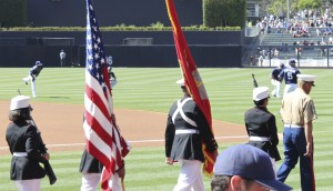 The flag is presented by the Junior ROTC Color Guard from Oceanside High School, one of the DoDEA consortium schools, before the Padres-Dodgers game in San Diego.