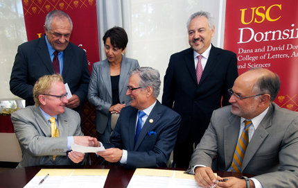USC Dornsife Dean Steve A. Kay, left, shakes hands with Ali Razi, chair of the Farhang Foundation board of trustees, during a recent signing ceremony. Al Checcio, senior vice president for USC Advancement, is sitting at right. Standing from left: Hassan Izad, Farhang's chief financial officer; Haleh Emrani, chair of Farhang's Iranian Studies Council; and Ahmad Gramian, vice chair of Farhang's board of trustees. (USC Photo/Dietmar Quistorf)