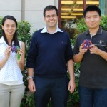 Remo Rohs with PhD candidates Carolina Dantas (holding a 3-D model of transcription factors bound to DNA) and Tianyin Zhou (holding a 3-D model of a nucleosome) (USC Photo/Susan Bell)