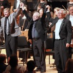 "Frank Ticheli, David St. John and John Alexander link hands and take a bow at the premiere of ""The Shore"" at the Segerstrom Center for the Arts. (Photo/Andy Templeton)"
