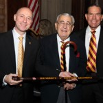 Robert Avakian, center, receives a custom USC cane from Ostrow School Avishai Sadan and Scott Adishian '75, DDS '79 during the 2011 Ostrow School of Dentistry Homecoming Dinner. (Photo/Glenn Marzano)