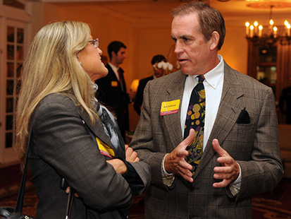 Jeff Fellenzer chats with a guest at a USC Annenberg event. (USC Photo/Gus Ruelas)