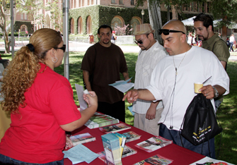 Visitors receive information from booths at Men's Health Awareness Day. (Photo/Ramon Ramos)