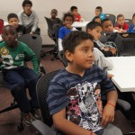 More than 80 boys, including Sebastian, front, participate in the Kinder2College literacy program at USC. (USC  Photo/Teresa Lara)