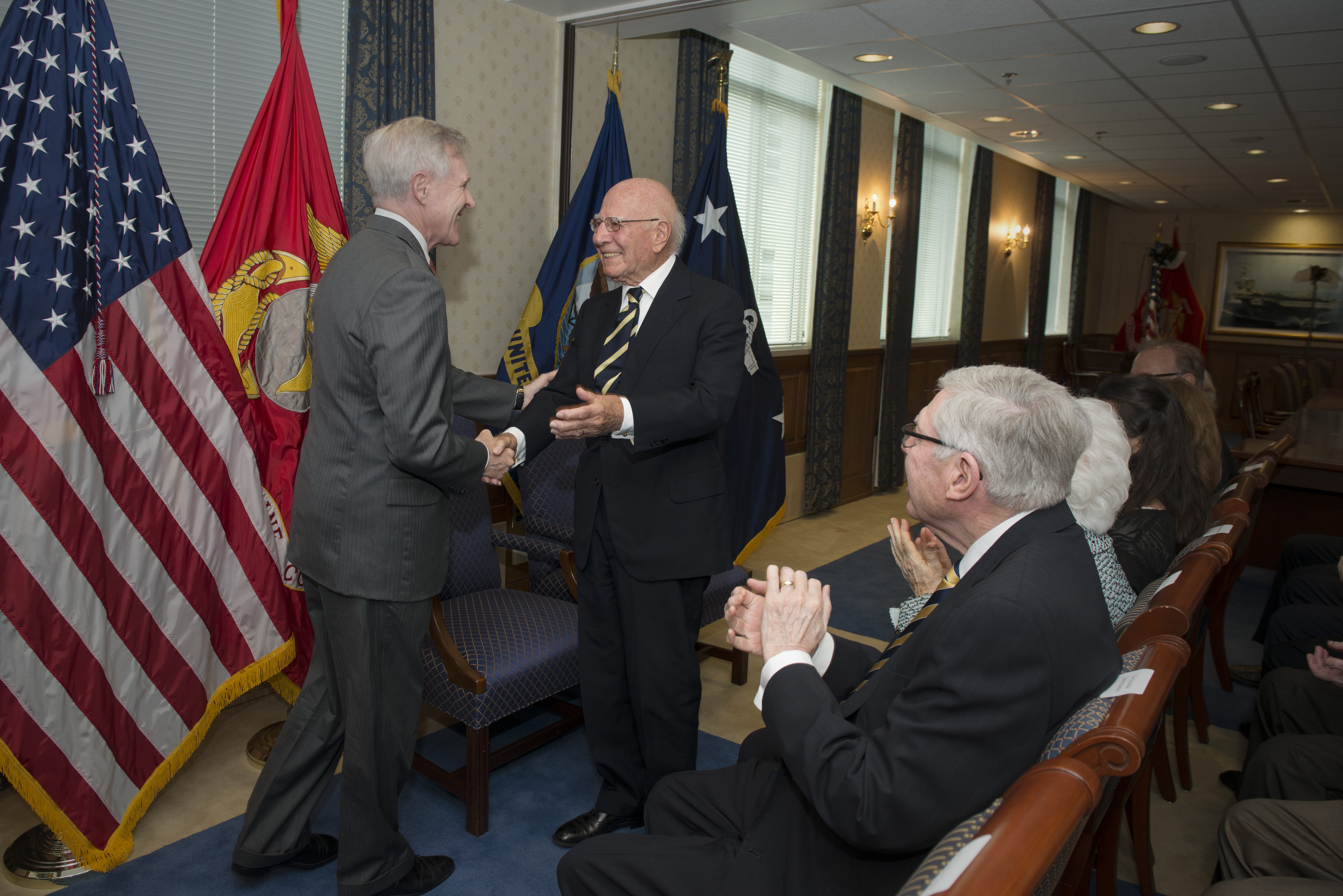 Paul Ignatius, right, is congratulated by Secretary of the Navy Ray Mabus during the Washington, D.C., ceremony celebrating the naming of the future USS Paul Ignatius. (Photo/Arif Patani)