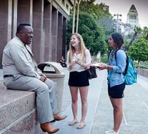 Alexa Palermo, center, and Jenny Elias with an interviewee in Grand Park (Photo/Alan Mittelstaedt)