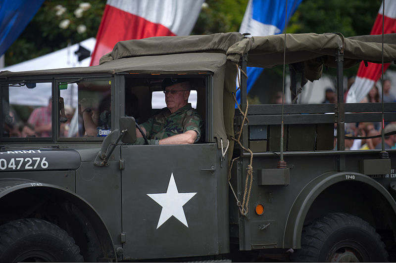A U.S. veteran drives a vintage military vehicle in this year's National Memorial Day Parade in Washington, D.C. (Photo/Teddy Wade)