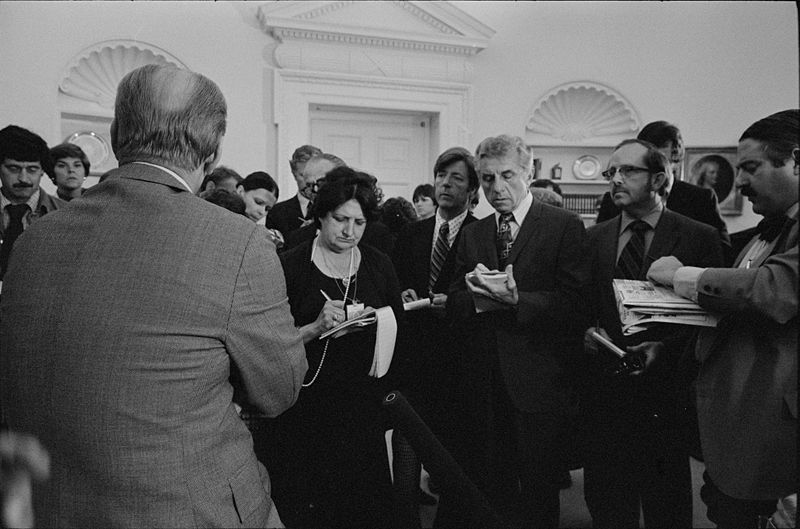 President Gerald Ford talks with reporters, including Helen Thomas, during a press conference at the White House. (Photo/Marion Trikosko)