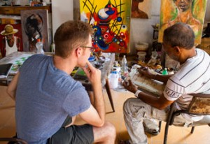 Owen Serra speaks with a Cuban artist who has a studio on Calle Obispo. (Photo/Anna Fishcher)