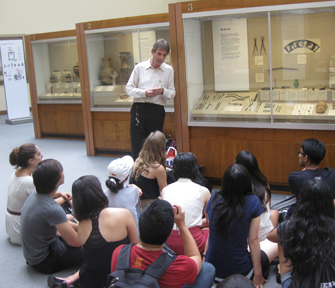 At the British Museum in London, students learn about Roman and Greek medical artifacts from Ralph Jackson, the museum's Romano-British Collection curator.  (Photo/Judy Haw)