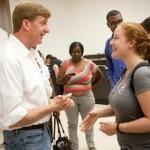 Patrick Kennedy speaks to a Trojan who attended his talk at the USC Gould School of Law. (Photo/Gregory Mancuso)