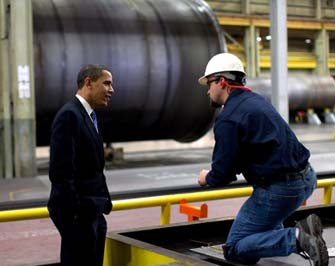 President Barack Obama speaks to a worker making wind tunnels at the Trinity Structural Towers Manufacturing Plant in Iowa. (Photo/Pete Souza)