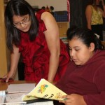 USC Rossier alumna Meg Palisoc works with one of the students at Synergy Charter Academy. (USC Photo/Kathy Christie)