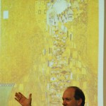 "E. Randol Schoenberg with a slide of Gustav Klimt's ""Portrait of Adele Bloch-Bauer I"" (USC Photo/Maria Iacobo)"