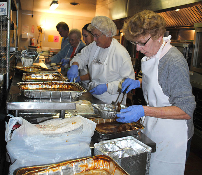 Volunteers at a community food bank serve others on Thanksgiving. (Photo/Katrina Heikkinen)