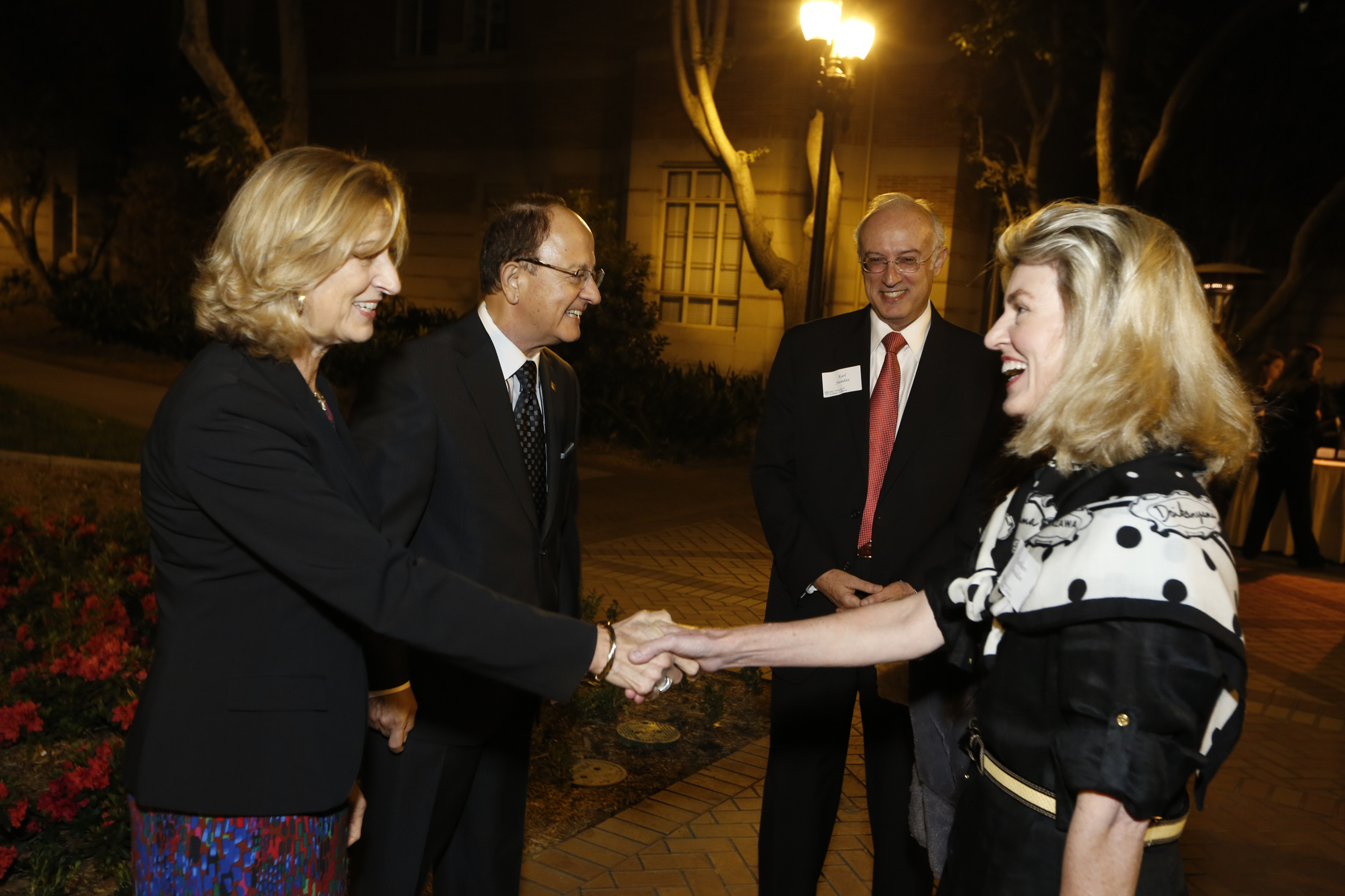 Niki C. Nikias and C. L. Max Nikais greet parents.