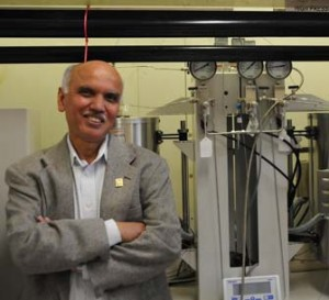 G.K. Surya Prakash, who has been honored by his home country of India, stands in front of his High Temperature-High Pressure Flow Reactor inside his lab for carbon dioxide conversions to methanol. (USC Photo/Pamela J. Johnson)