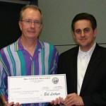 In 2007, William Tierney accepted a check supporting the SummerTIME program from California State Treasurer Bill Lockyer. (Photo/courtesy of USC Rossier)