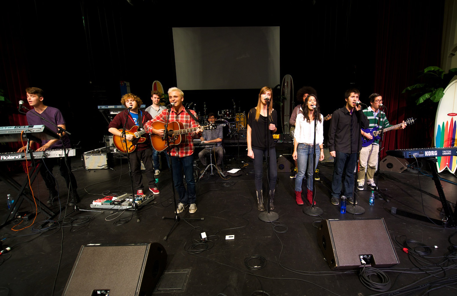 "USC Thornton Popular Music Performance students rehearse ""American Champagne,"" written by Rees Finley (in red plaid shirt) the night before opening for The Beach Boys. (USC Photo/Dietmar Quistorf)"