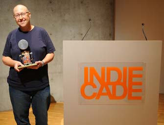 Tracy Fullerton accept her award at IndieCade.