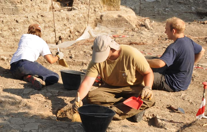 Students digging on a site