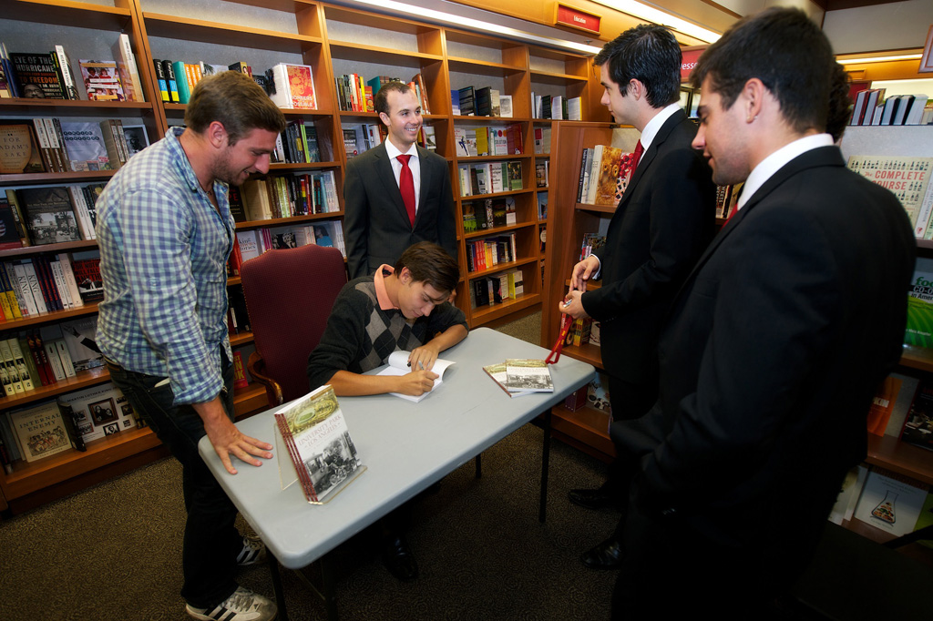Charles Epting signs his new book at the USC Pertusati Bookstore. (USC Photo/Dietmar Quistorf)